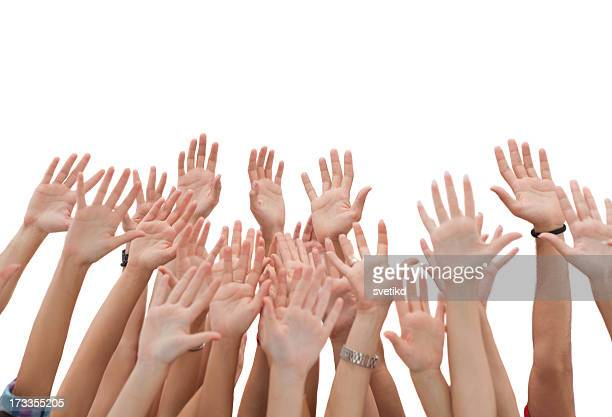 Group of young people's hands raised up.
