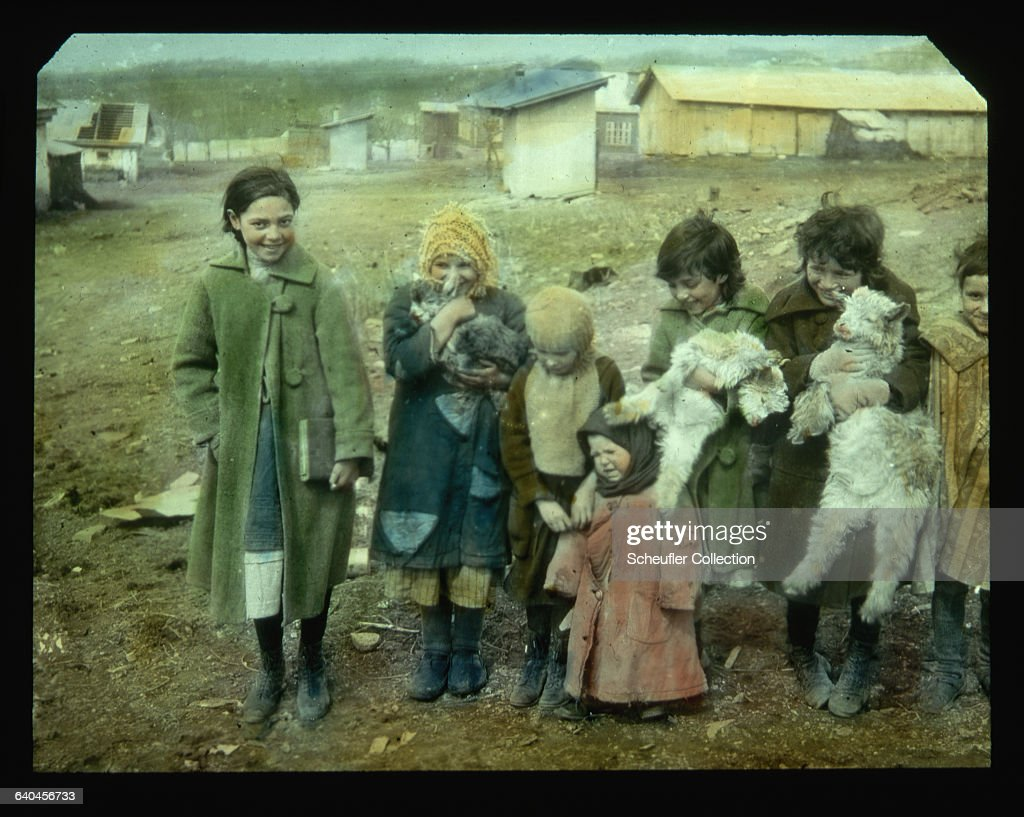 A group of young Russian children together with their nanny goats Russia ca 1920