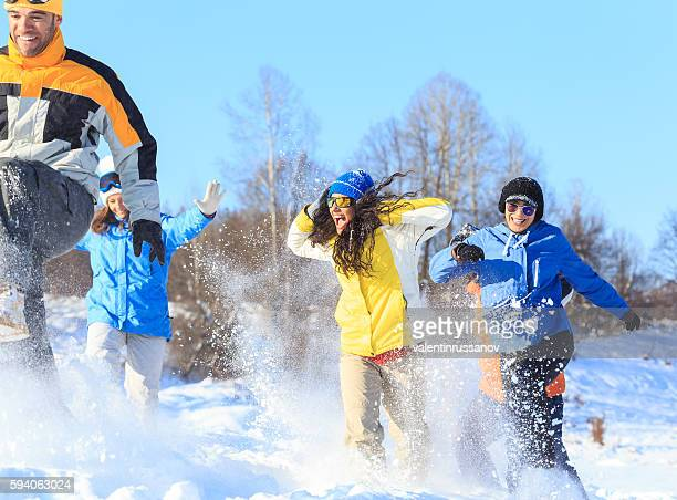 Group of young skiers having fun in the snow