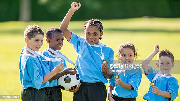 Group of Young Soccer Players Cheering