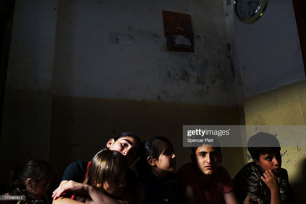 A group of young Syrians from the the city of Idlib are viewed in the home they share with over 20 extended members of their family in a poor neighborhood with a high concentration of Syrian refugees on July 01, 2013 in Beirut, Lebanon. Currently the Lebanese government officially hosts 546,000 Syrians with an estimated additional 500,000 who have not registered with the United Nations. Lebanon, a country of only 4 million people, is now home to the largest number of Syrian refugees who have fled the conflict. The situation is beginning to put a huge social and political strains on Lebanon as there is currently no end in sight to the war in Syria.