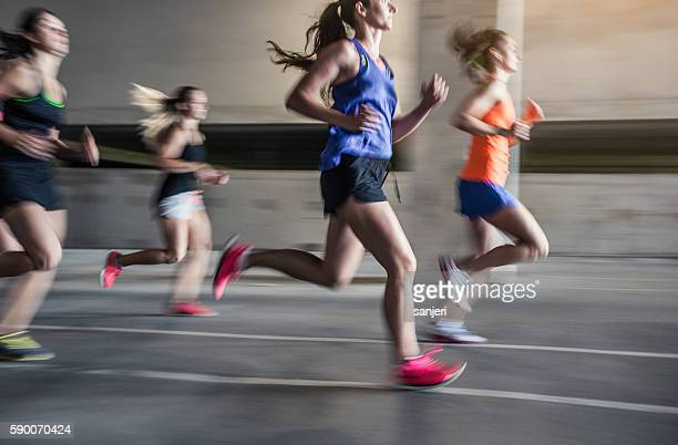 Group of young woman running outdoors