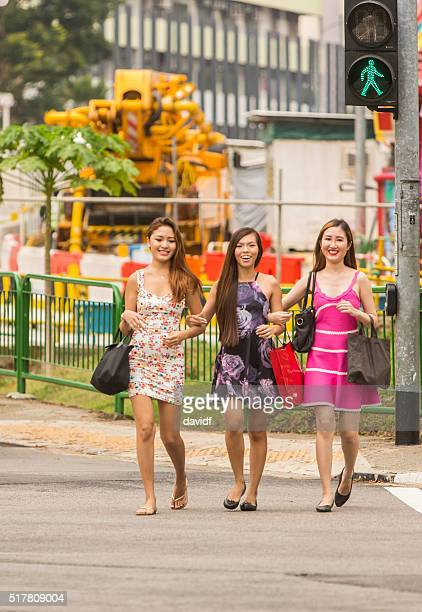 Group of Young Women Crossing the Road in Singapore