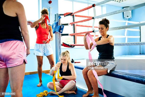 Group of young women getting ready for kickboxing practice