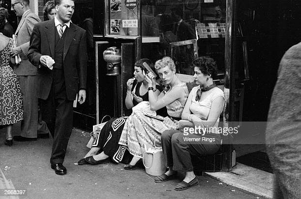 A group of young women 'hanging out' on the streets of Soho London