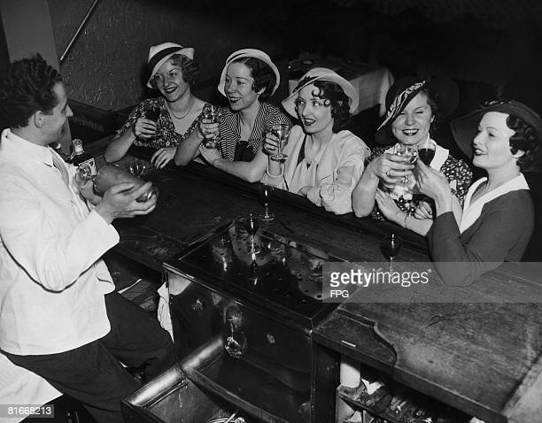 A group of young women in New York take advantage of a change in the licensing laws permitting customers to drink while standing at the bar 21st May...