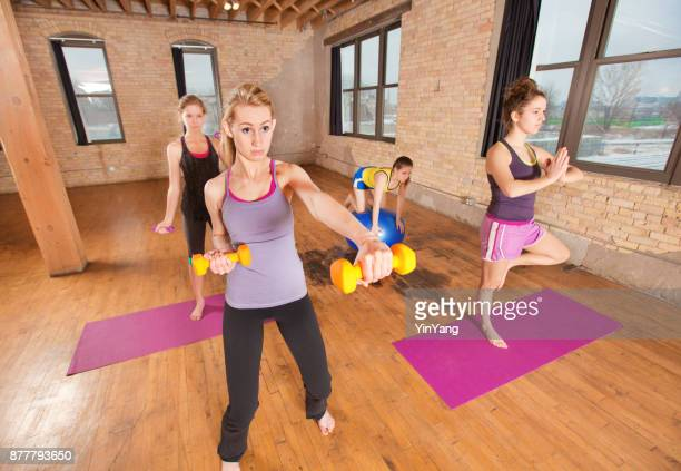 Group of Young Women in Yoga Aerobic Exercise Health Center Studio