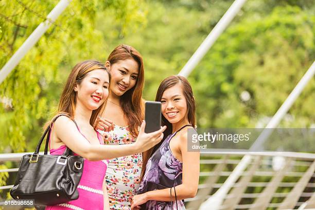 Group of Young Women Taking a Selfie in Singapore