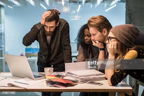 Group of young worried people having problems at work.