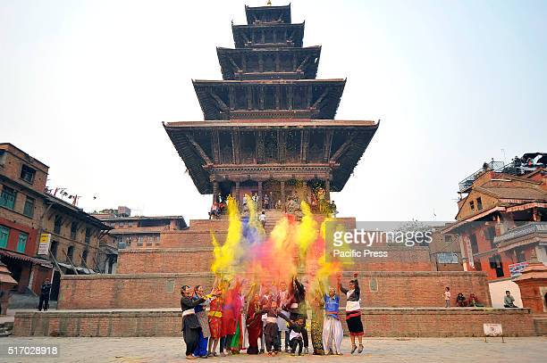 A group of youth in a traditional attire celebrates Holi the festivals of colors by throwing colorful powder People celebrate Holi all over Nepal as...