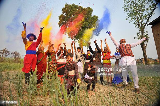 A group of youth in a traditional attire celebrates Holi the festivals of colors by throwing colorful powder each other People celebrate Holi in all...