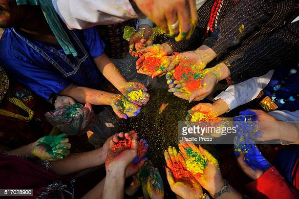 A group of youth in a traditional attire with colorful powder celebrates Holi the festivals of colors People celebrate Holi all over Nepal as well as...
