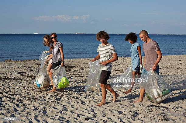 Group people collecting trash on beach