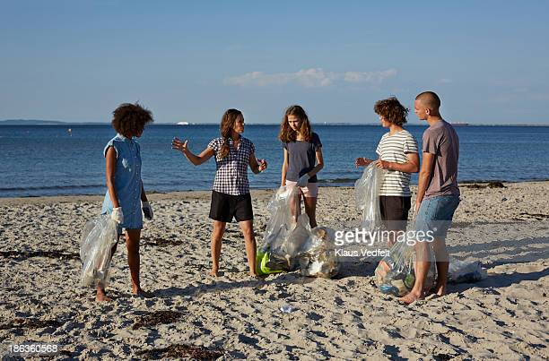 Group people coordinating beach clean