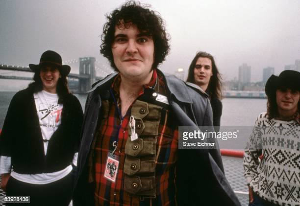 Group photo of John Popper and other members of the group Blues Traveler with the Brooklyn Bridge in the background 1989 New York