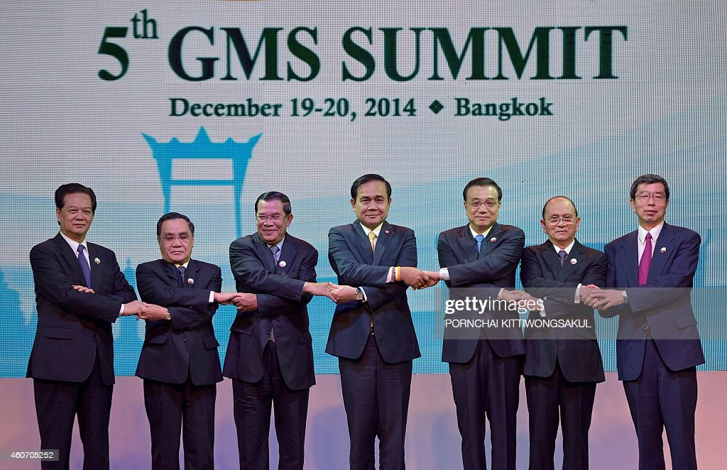 A group photo of the six leaders (L to R) Vietnam Prime Minister <a gi-track='captionPersonalityLinkClicked' href=/galleries/search?phrase=Nguyen+Tan+Dung&family=editorial&specificpeople=544511 ng-click='$event.stopPropagation()'>Nguyen Tan Dung</a>, Laos Prime Minister Thongsing Thammavong, Cambodian Prime Minister <a gi-track='captionPersonalityLinkClicked' href=/galleries/search?phrase=Hun+Sen&family=editorial&specificpeople=224084 ng-click='$event.stopPropagation()'>Hun Sen</a>, Thai Prime Minister Prayut Chan-o-cha, Chinese Prime Minister <a gi-track='captionPersonalityLinkClicked' href=/galleries/search?phrase=Li+Keqiang&family=editorial&specificpeople=2481781 ng-click='$event.stopPropagation()'>Li Keqiang</a>, Myanmar President <a gi-track='captionPersonalityLinkClicked' href=/galleries/search?phrase=Thein+Sein&family=editorial&specificpeople=787536 ng-click='$event.stopPropagation()'>Thein Sein</a>, and President of Asian Development Bank (ADB) Takehiko Nakao linking their hands during the opening ceremony of the 5th Summit of the Greater Mekong Subregion Economic Cooperation Program in Bangkok on December 20, 2014. The Greater Mekong Subregion (GMS) Program is the cooperation between 6 countries, namely Thailand, Myanmar, Lao PDR, Cambodia, Vietnam, and China, with the Asian Development Bank as key donor. The Program is aimed to promote expansion of trade and investment, industry, agriculture, and services, as well as local employment to upgrade the peoples livelihood. AFP PHOTO / PORNCHAI KITTIWONGSAKUL