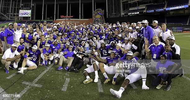 A group photo of the Tulsa Golden Hurricane team after the Miami Beach Bowl game against the Central Michigan Chippewas at Marlins Park on December...