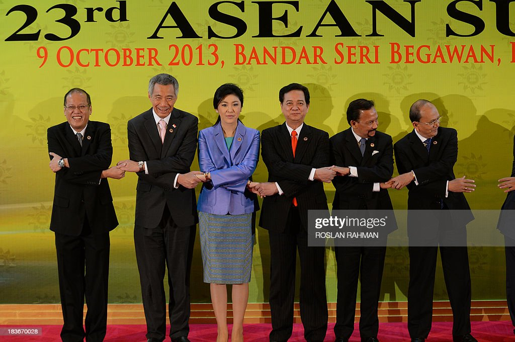 A group photograph of ASEAN leaders (from L-R) Philippine President Benigno Aquino, Singapore Prime Minister Lee Hsien Loong, Thailand's Prime Minister Yingluck Shinawatra , Vietnamese Prime Minister Nguyen Tan Dung, Brunei's Sultan Hassanal Bolkiah, and Myanmar's President Thein Sein during the 23rd summit of the Association of Southeast Asian Nations (ASEAN) in Bandar Seri Begawan on October 9, 2013, Festering territorial disputes provided the backdrop for an Asian summit kicking off on October 9 with China flexing its diplomatic muscle in the absence of a grounded US President Barack Obama.