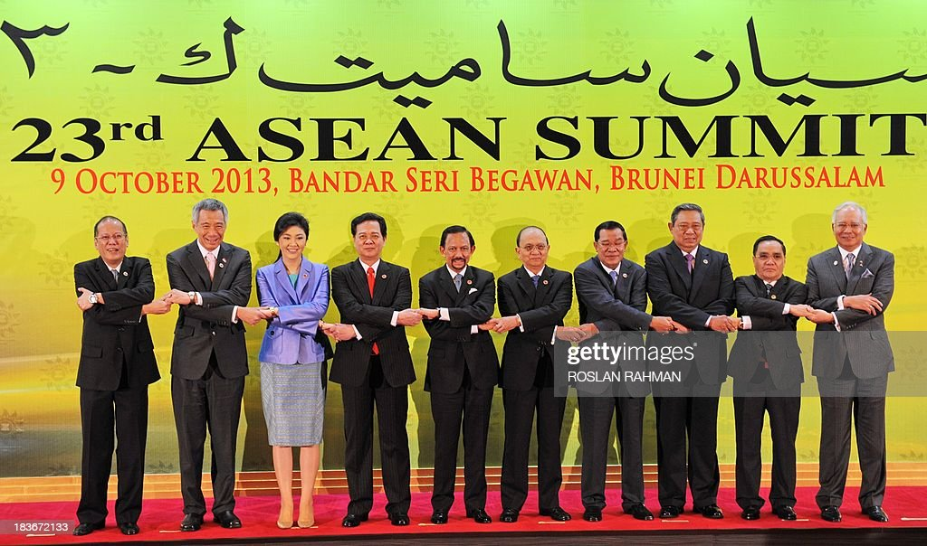 A group photograph of ASEAN leaders (L-R) Philippine President Benigno Aquino, Singapore Prime Minister Lee Hsien Loong, Thailand's Prime Minister Yingluck Shinawatra , Vietnamese Prime Minister Nguyen Tan Dung,Brunei's Sultan Hassanal Bolkiah, Myanmar President Thein Sein, Cambodian Prime Minister Hun Sen, Indonesia's President Susilo Bambang Yudhoyono, Laos Prime Minister Thongsing Thammavong and Malaysian Prime Minister Najib Razak during the 23rd summit of the Association of Southeast Asian Nations (ASEAN) in Bandar Seri Begawan on October 9, 2013,
