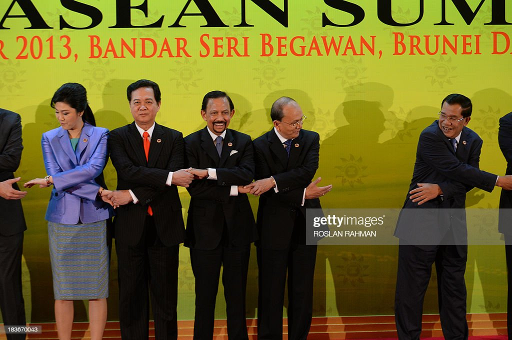 A group photograph of ASEAN leaders (from L-R) Thailand's Prime Minister Yingluck Shinawatra , Vietnamese Prime Minister Nguyen Tan Dung, Brunei's Sultan Hassanal Bolkiah, Myanmar's President Thein Sein and Cambodian Prime Minister Hun Sen during the 23rd summit of the Association of Southeast Asian Nations (ASEAN) in Bandar Seri Begawan on October 9, 2013, Festering territorial disputes provided the backdrop for an Asian summit kicking off on October 9 with China flexing its diplomatic muscle in the absence of a grounded US President Barack Obama.