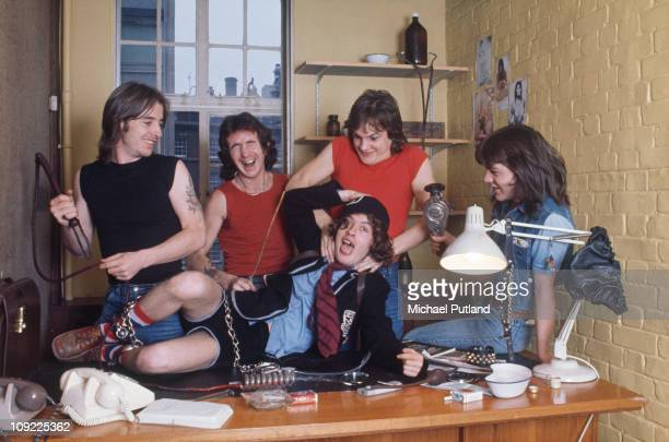 AC/DC group portrait London July 1976 LR Phil Rudd Bon Scott Angus Young Mark Evans Malcolm Young