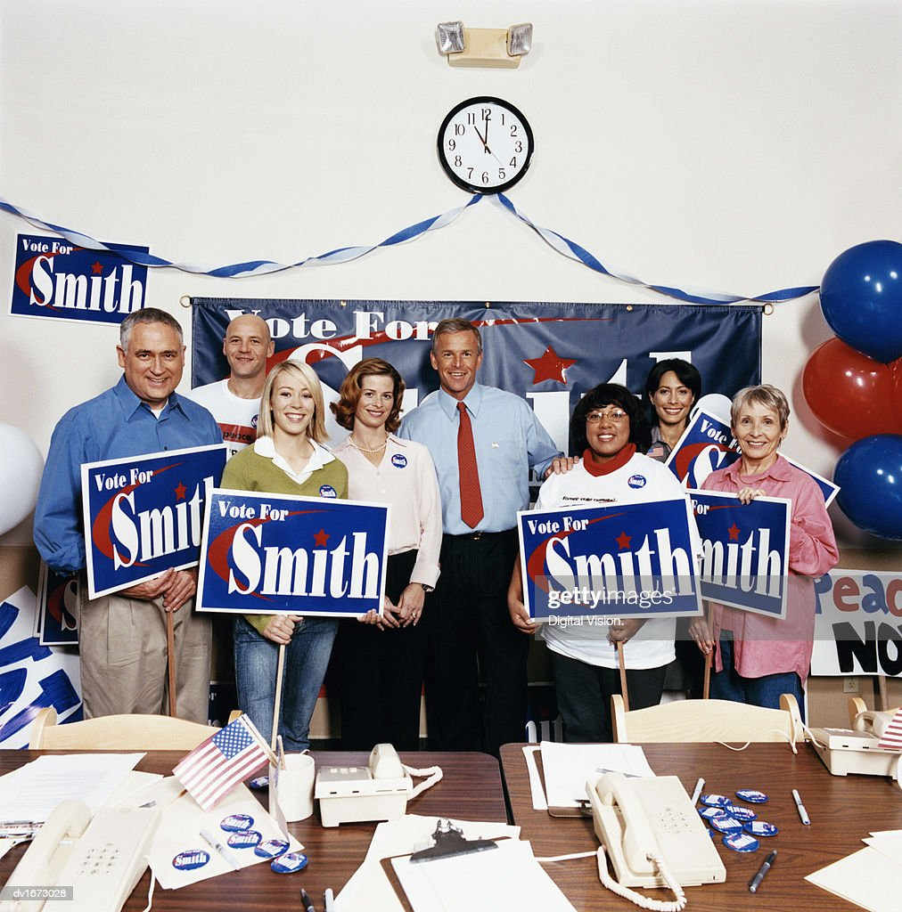 Group Portrait of a Politician With Colleagues in an Office During an Election Campaign