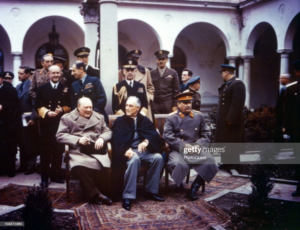 Group portrait of Allied leaders at the Yalta Conference held at the Livadia Palace, Livadiya (near Yalta), Soviet Union (later Ukraine), February 1945. Seated are, from left, British Prime Minister <a gi-track='captionPersonalityLinkClicked' href=/galleries/search?phrase=Winston+Churchill+-+Prime+Minister&family=editorial&specificpeople=92991 ng-click='$event.stopPropagation()'>Winston Churchill</a> (1874 - 1965), American President Franklin Delano Roosevelt (1882 - 1945) (seated left) and Soviet General Secretary <a gi-track='captionPersonalityLinkClicked' href=/galleries/search?phrase=Joseph+Stalin&family=editorial&specificpeople=91259 ng-click='$event.stopPropagation()'>Joseph Stalin</a> (1878 - 1953). Among those behind them are British Admiral of the Fleet Sir <a gi-track='captionPersonalityLinkClicked' href=/galleries/search?phrase=Andrew+Cunningham&family=editorial&specificpeople=215543 ng-click='$event.stopPropagation()'>Andrew Cunningham</a> (1883 - 1963) (directly above Churchill's right sleeve), British Marshal of the Royal Air Force Sir Charles Portal (1893 - 1971) (in profile, behind Churchill), and American Fleet Admiral William D. Leahy (1875 - 1959) (behind Roosevelt, with shoulder braids).