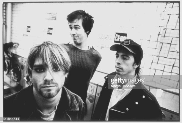 Group portrait of American grunge band Nirvana in Shepherd's Bush London October 1990 LR Kurt Cobain Krist Novoselic and Dave Grohl