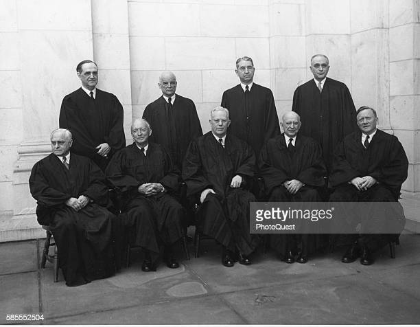 Group portrait of Chief Justice Earl Warren and the justices of the United States Supreme Court Washington DC 1955 Pictured are seeated from left...