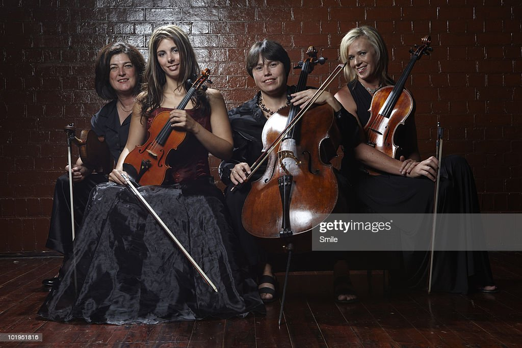 Group portrait of classical musicians : Stock Photo