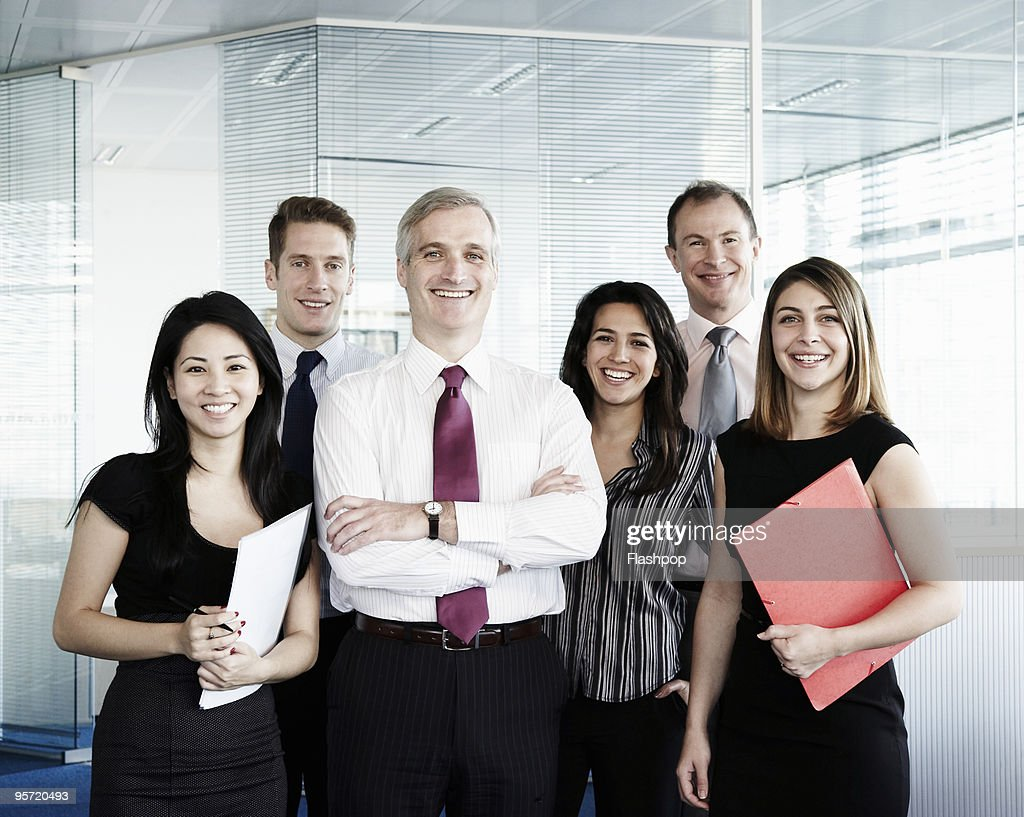 Group portrait of colleagues at work : Stock Photo