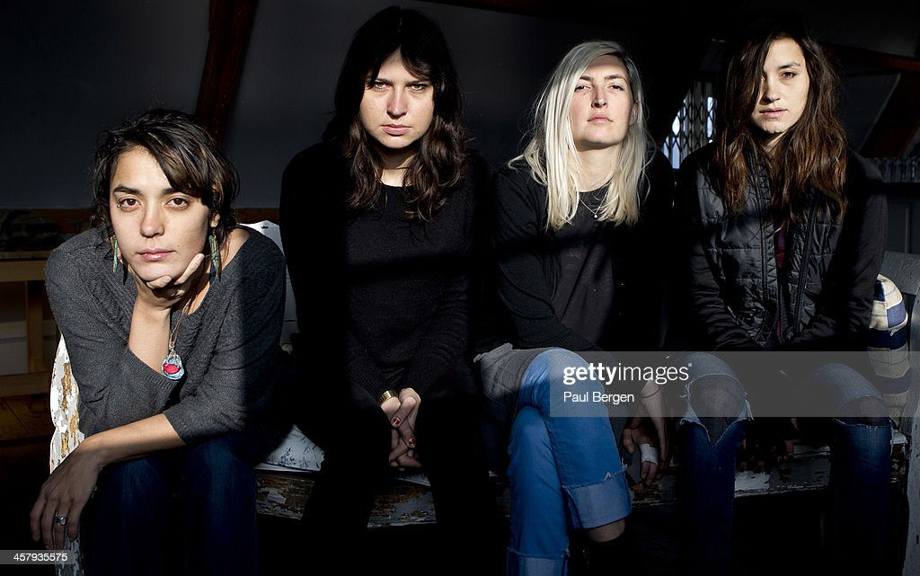 Group portrait of female American indie rock group Warpaint, Amsterdam, Netherlands, 18 November 2013. L-R Jenny Lee Lindberg, Stella Mozgawa, Emily Kokal, Theresa Wayman.