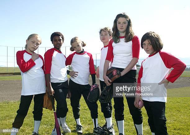 group portrait of girl softball players