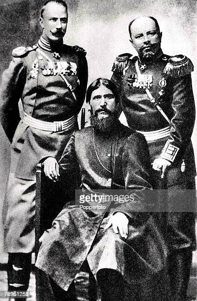A group portrait of Gregory Rasputin the famous Siberian peasant monk seated between FlightAdjutant Colonel Loman and Prince Putjatin