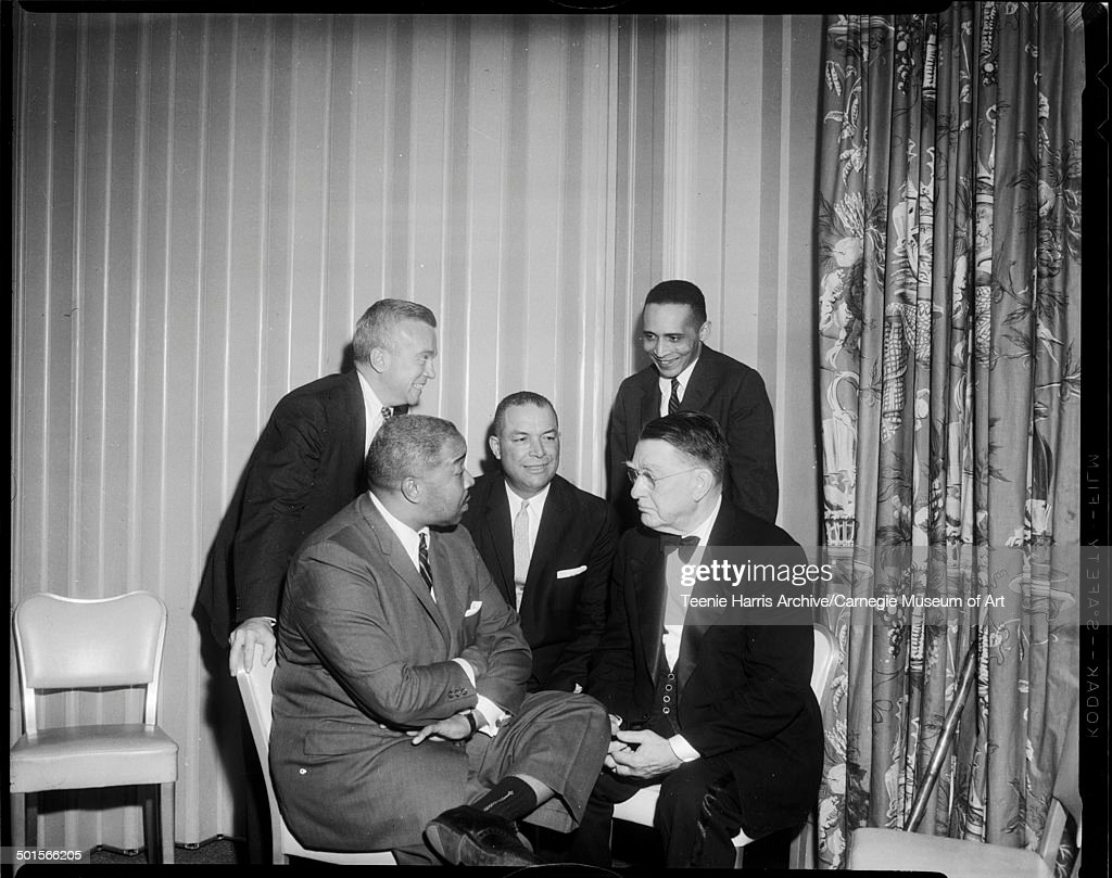 Group portrait of guests at an NAACP Human Rights dinner in the Hotel Penn Sheraton, Pittsburgh, Pennsylvania, May 1961. Pictured are, from left, American politician Congressman William S Moorhead (1923 - 1987), lawyer, Civil Rights activist, and special assistant to President Kennedy Frank D Reeves (1916 - 1973), Pittsburgh Housing Association director Roland M Sawyer, baseball executive Branch Rickey (1881 - 1965) (seated, fore), and Pittsburgh NAACP president, lawyer, and Civil Rights activist Byrd Brown (1929 - 2001).