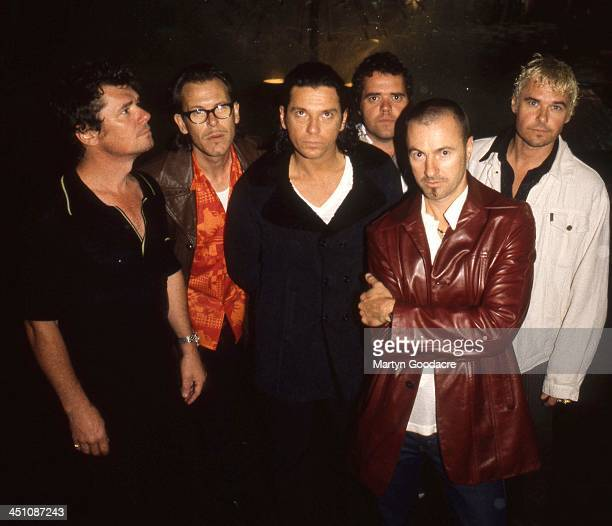 Group portrait of INXS with Michael Hutchence in Kings Cross Australia 1996
