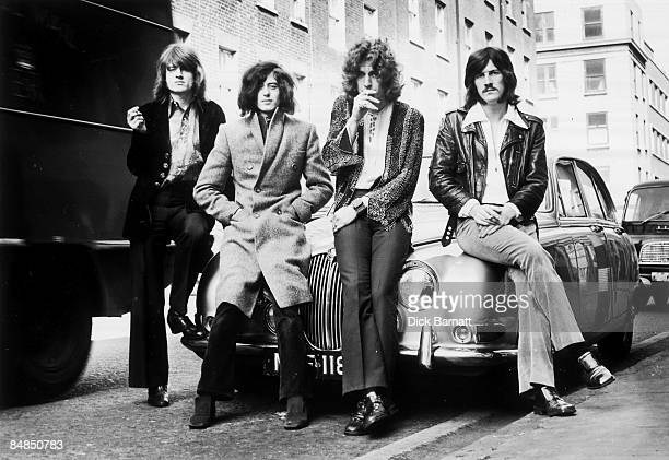 Photo of LED ZEPPELIN first photo session with WEA Records posed on a Jaguar car in a London street in December 1968 Left to right John Paul Jones...