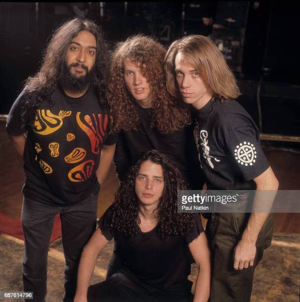 Group portrait of members of the Rock band Soundgarden as they pose at the Vic Theater Chicago Illinois January 14 1990 Pictured are standing from...