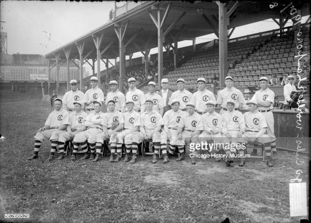 Group portrait of National League's Chicago Cubs baseball team players World Champions 1908 posing for a photograph on the field at West Side Grounds...
