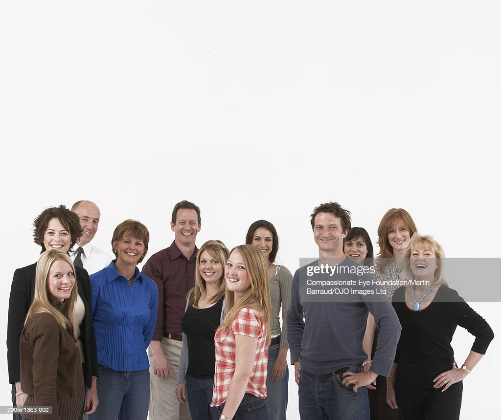 Group portrait of people standing against white background : Stock Photo