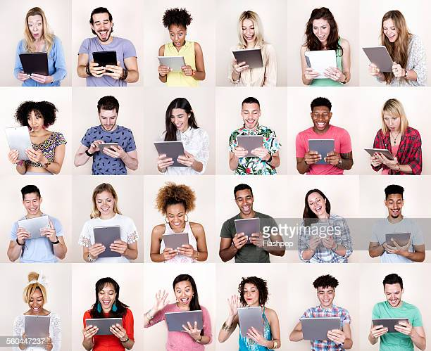 Group portrait of people using digital tablets