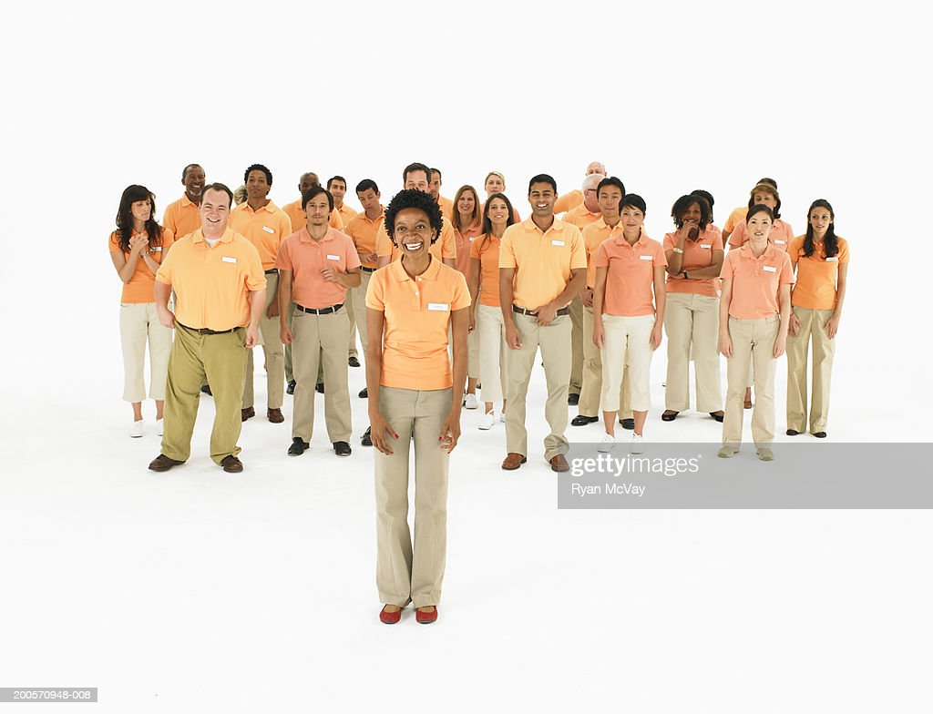 Group portrait of people wearing orange polo shirts