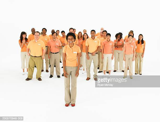 Group portrait of people wearing orange polo shirts