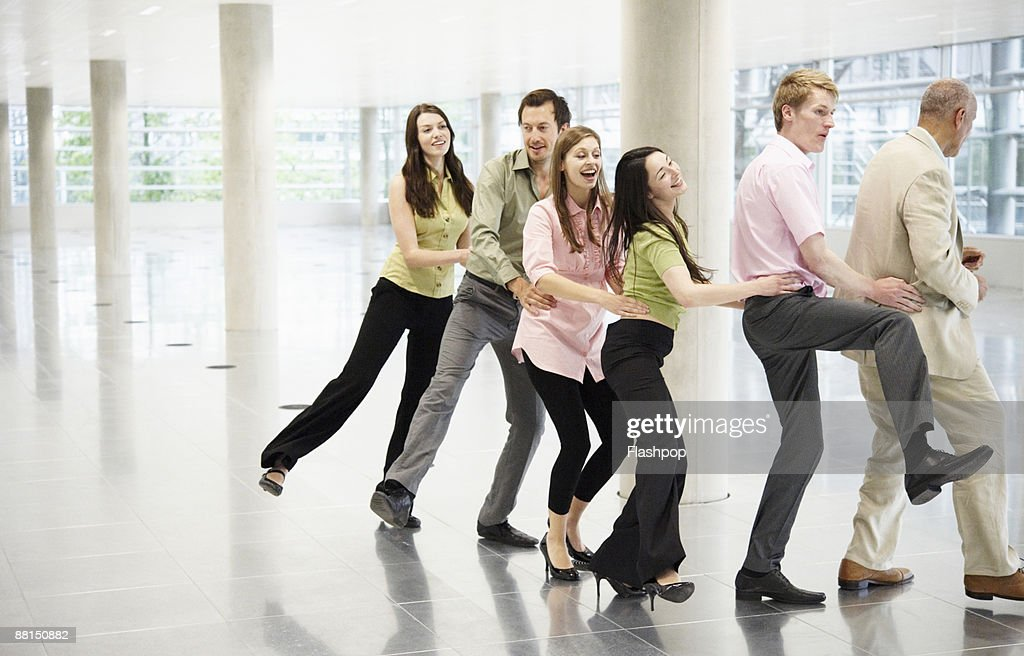 Group portrait of professional people celebrating : Stock Photo