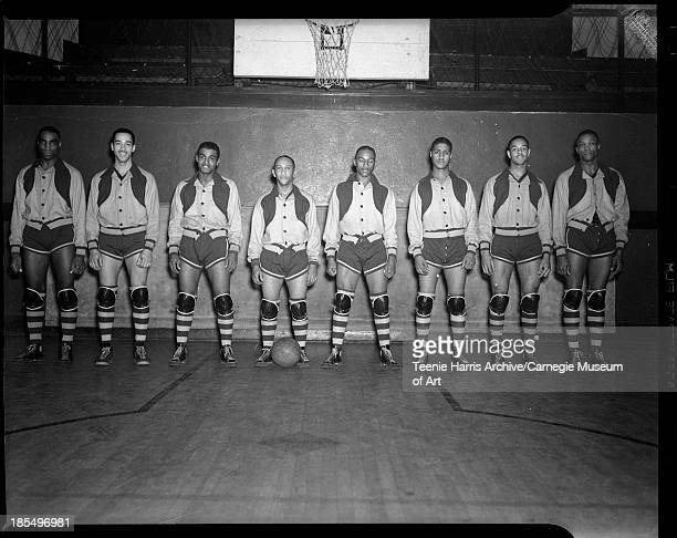 Group portrait of Renaissance 'Rens' basketball team members in gymnasium with basketball hoop in background Pittsburgh Pennsylvania January 7 1939...