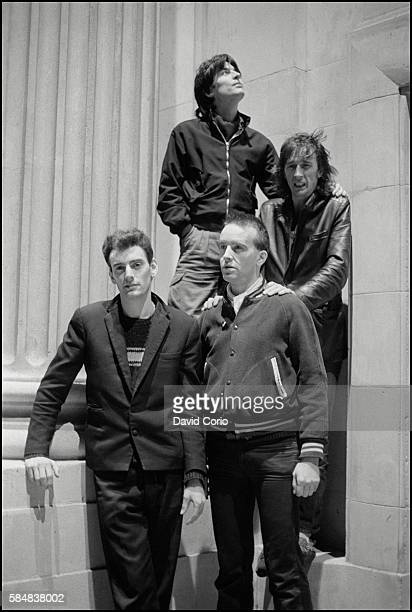 Group portrait of Ruts DC on Kilburn High Road London 1981
