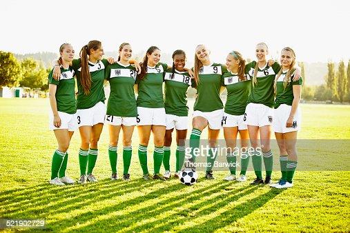 Group portrait of smiling female soccer team