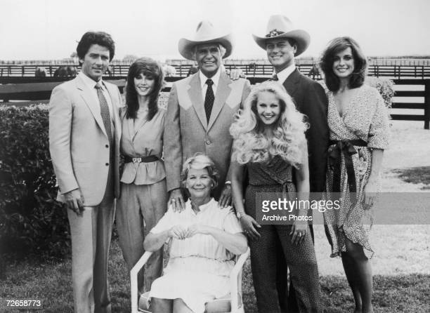 A group portrait of the Ewing family from the US television soap opera 'Dallas' circa 1980 Standing left to right Bobby Pam Jock Lucy JR and Sue...