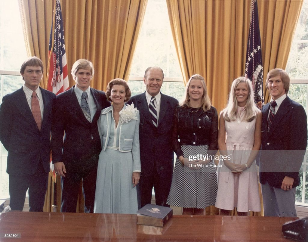 Group portrait of the First Family in the White House's Oval Office Washington DC August 9 1974 Left to right son Steven Ford son John Ford First...