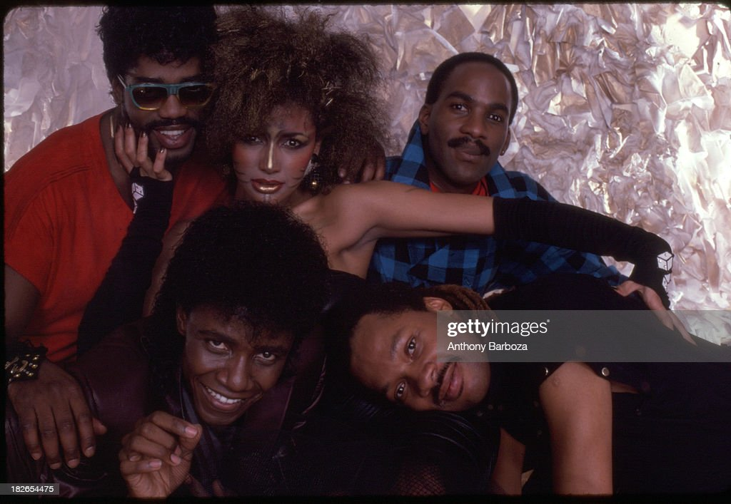 Group portrait of the members of American rhythm & blues and funk band Cameo, 1984. The singer and actress Vanity is pictured with the group.
